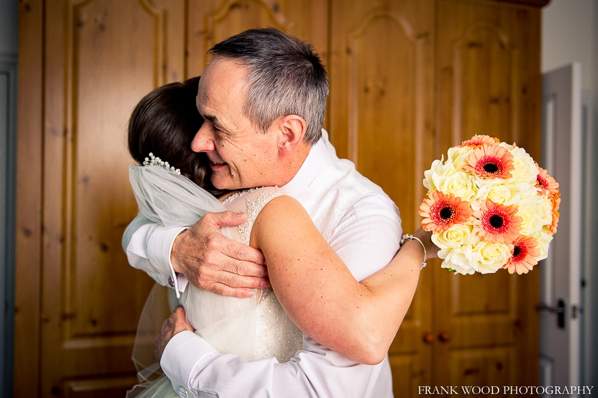 Bride hugging bride's father